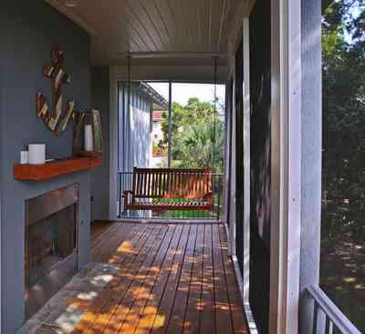 400+LaRua+Landing-2nd+floor+side+porch_01.jpg:  fireplace, porch swing, Coastal home, Pensacola,