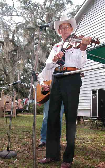 Bagdad:-Church-Museum_05.jpg:  fiddler, country music, guitar, spanish moss, oak tree, museum, bake sale, market day