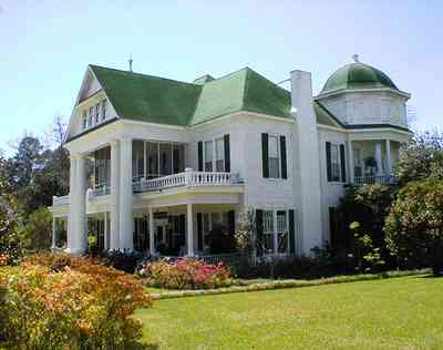 Brewton:-Belleville-Avenue_02.jpg:  victorian mansion, front porch, greek revival facade, classical revival, columns, azalea bushes, turret, colonnade