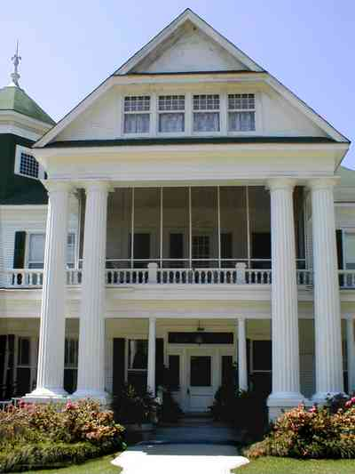 Brewton:-Belleville-Avenue_03.jpg:  victorian mansion, front porch, greek revival facade, classical revival, columns, azalea bushes, turret, colonnade, ionic columns, dormer window, side porch,