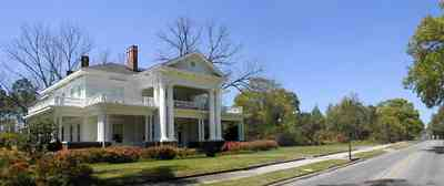 Brewton:-Belleville-Avenue_04.jpg:  victorian mansion, front porch, greek revival facade, classical revival, columns, azalea bushes, turret, colonnade