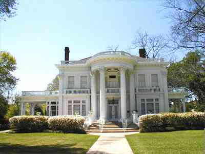 Brewton:-Belleville-Avenue_07.jpg:  victorian mansion, front porch, greek revival facade, classical revival, columns, azalea bushes, turret, colonnade