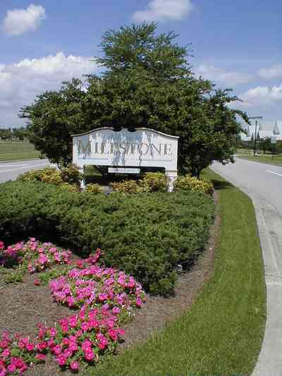 Cantonment:-Milestone_01.jpg:  sign, development, subdivision, petunia, median