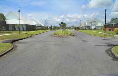Cantonment:-Milestone_19.jpg:  cumulus clouds, oak trees, boulevard, tract houses,  garden