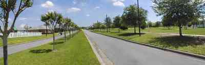 Cantonment:-Milestone_21.jpg:  cumulus clouds, oak trees, boulevard, tract houses,  garden, crepe myrtle trees, ,