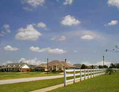 Cantonment:-Milestone_23.jpg:  cumulus clouds, oak trees, boulevard, tract houses, white board fence,  garden