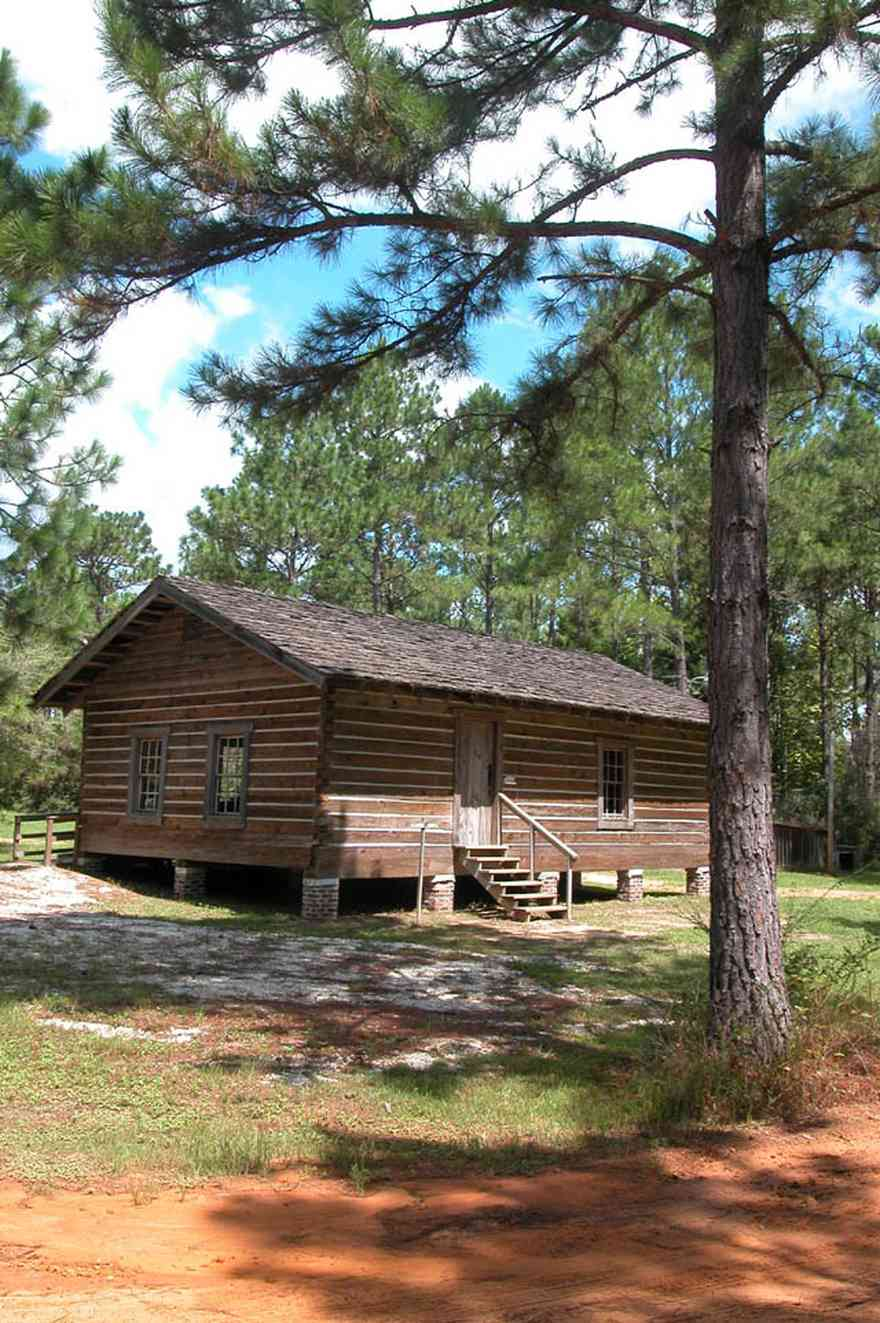 Cantonment:-Roy-Hyatt-Environmental-Center-Schoolhouse_01.jpg:  school, one-room schoolhouse, log cabin, pine trees, shake roof, wooden roof, cabin in the woods, single-pen house