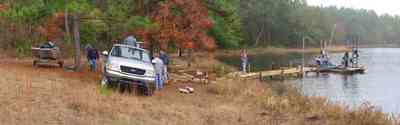 Century:-Bluff-Springs-Campground_11.jpg:  lake, oak tree, pine tree, fog, ford truck