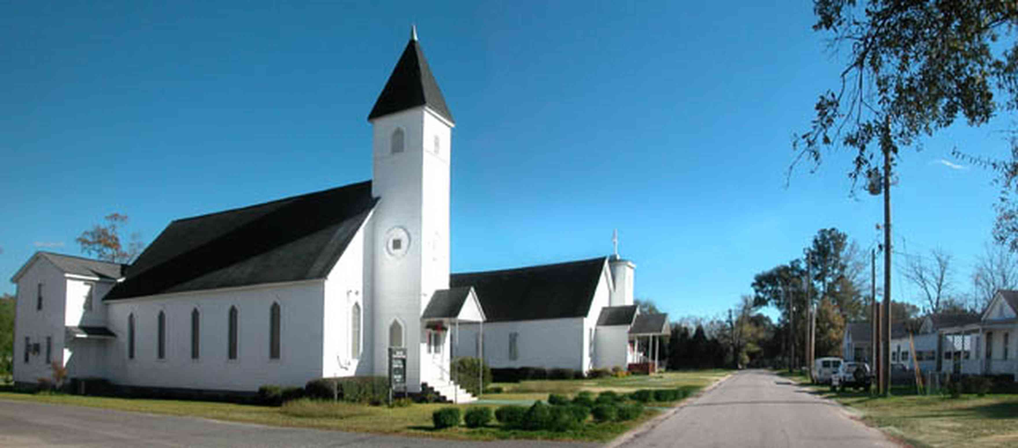 Century:-First-Baptist-Church_01.jpg:  church, steeple, cross, small town two-lane street,