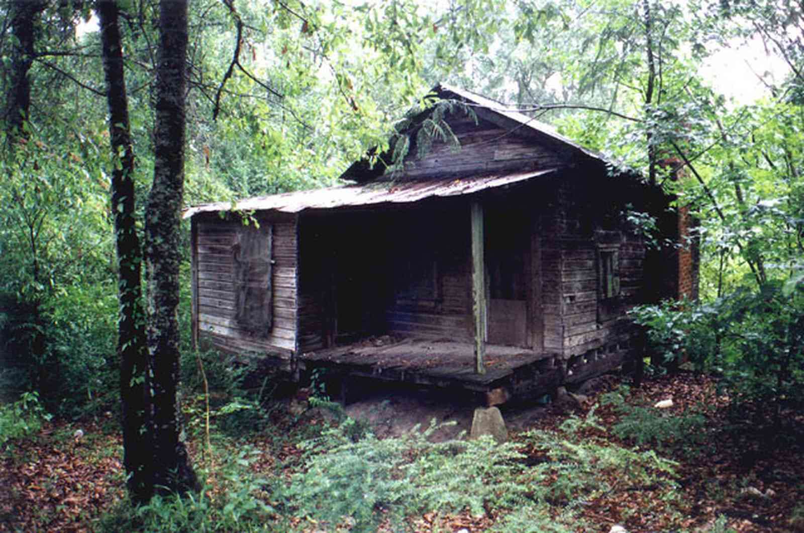 Century:-Shotgun-Mill-Houses_02.jpg:  shack, falling down house, dilipated house, junk pile