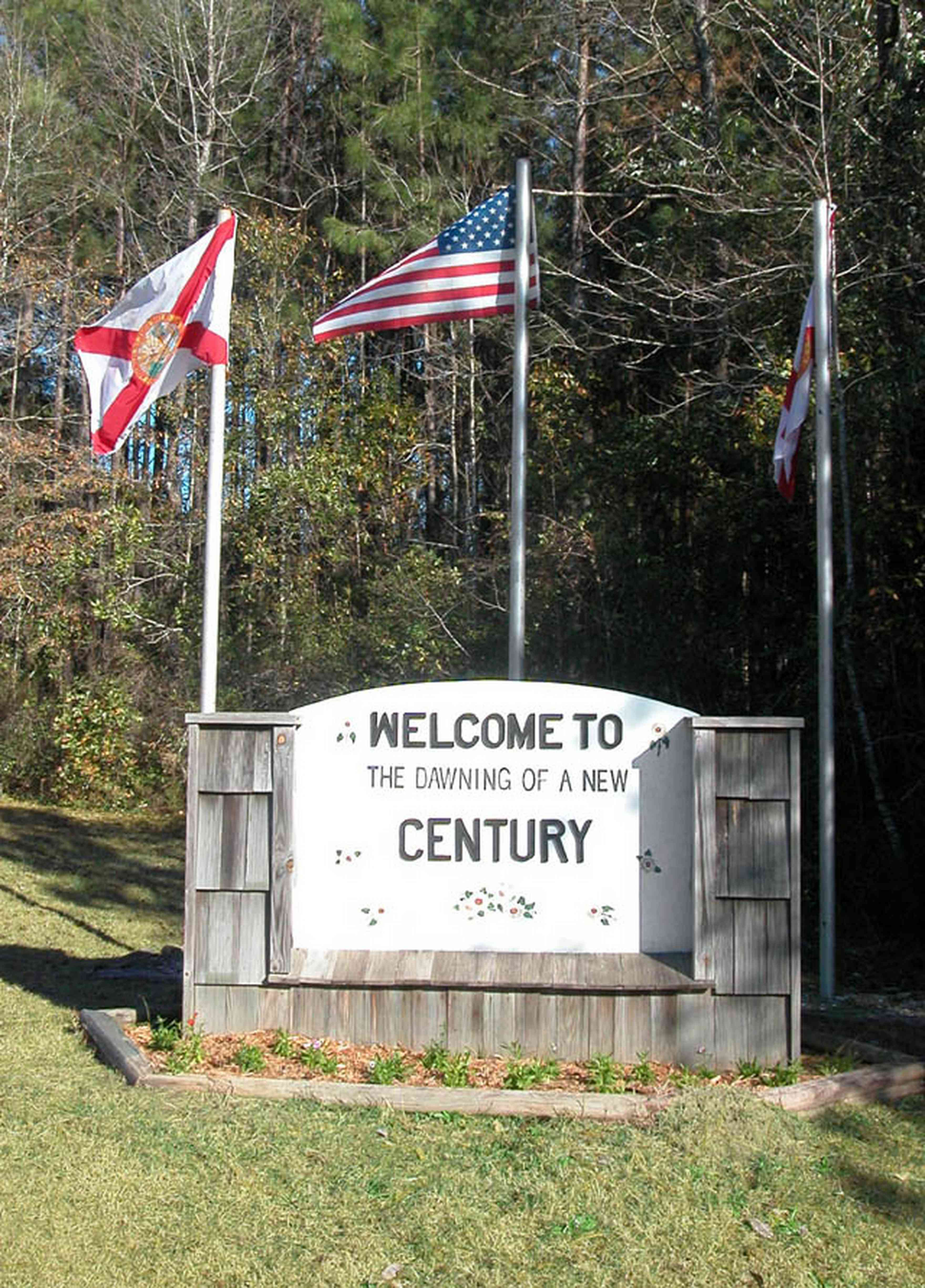 Century:-Town-Sign_01.jpg:  small town, flags, sign, town entrance