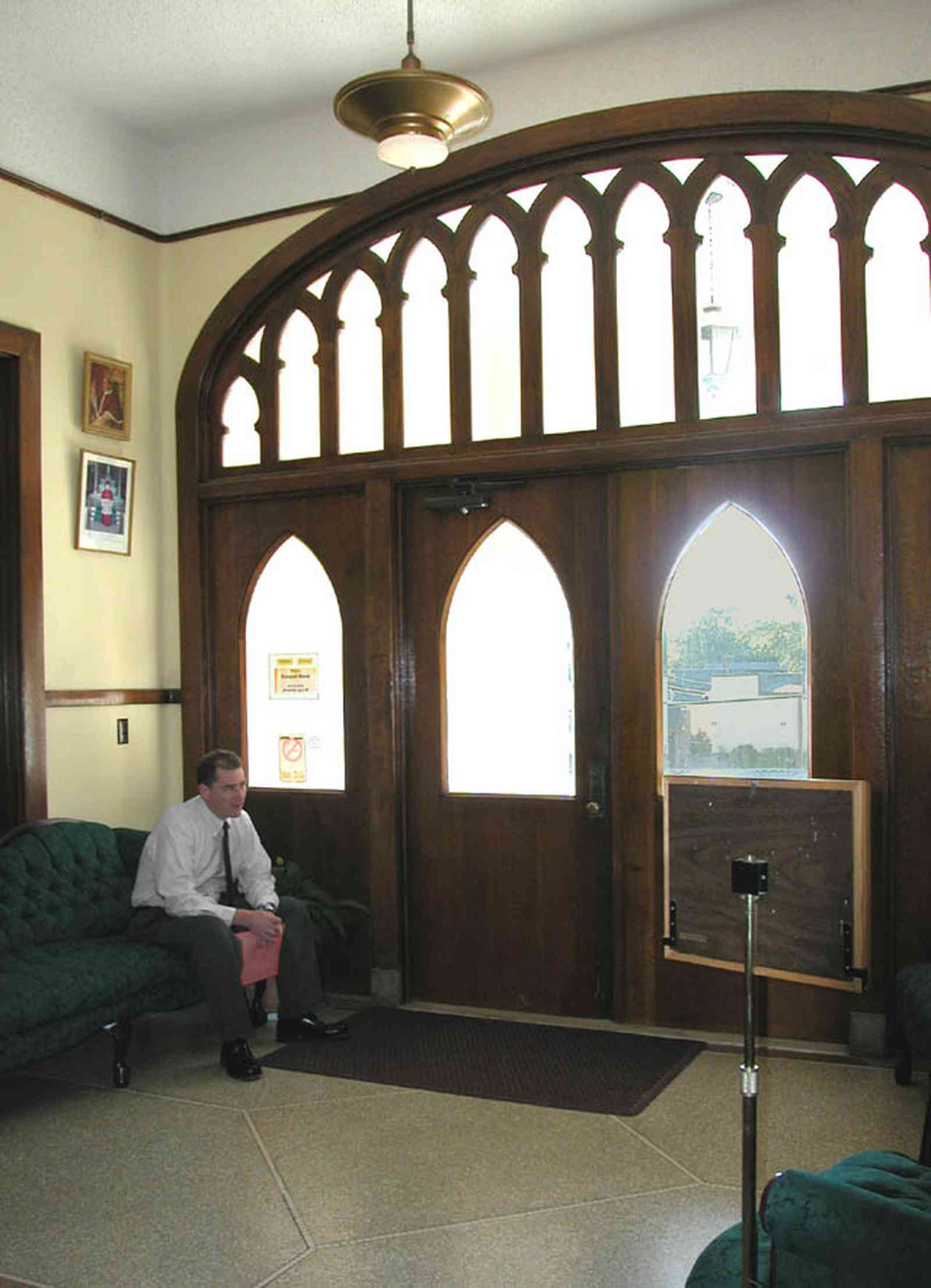 East-Hill:-Tower-East:-Old-Sacred-Heart-Hospital_35a.jpg:  front door, reception area, sofa, granite floor, clestory tracery, gothic revivial architectural style, beveled glass window