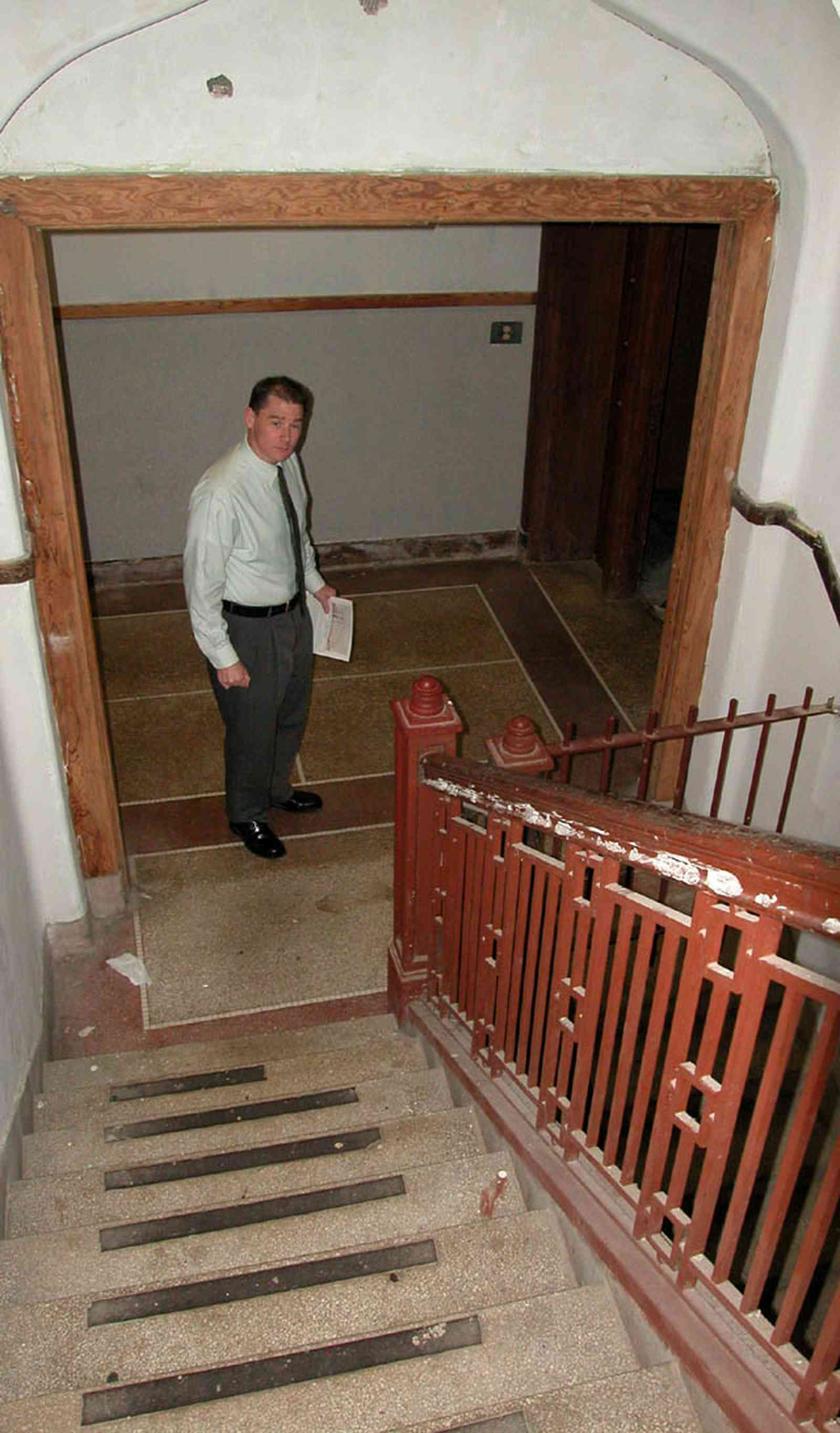 East-Hill:-Tower-East:-Old-Sacred-Heart-Hospital_42.jpg:  metal balustrade, iron gate, granite floor, cellar