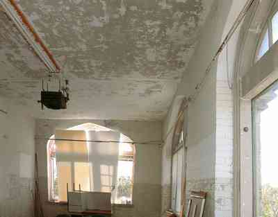 East-Hill:-Tower-East:-Old-Sacred-Heart-Hospital_45b.jpg:  gothic revival architecture, plaster walls, upstairs windows