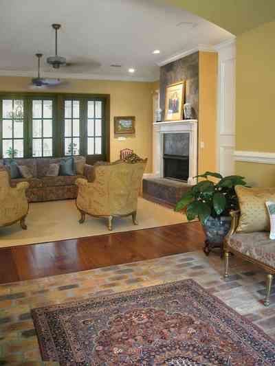 East-Pensacola-Heights:-112-Chipley-Avenue_05.jpg:  brick floor, oriental rug, brocade fabric, ceiling fan, divided panes, heart-pine floor