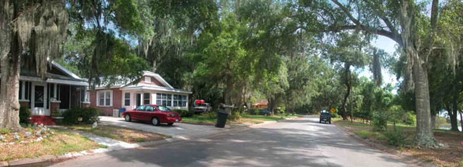 East-Pensacola-Heights:-118-Bayou-Blvd_05.jpg:  craftsman cottage, spanish moss, bayou texar, oak tree, red brick house