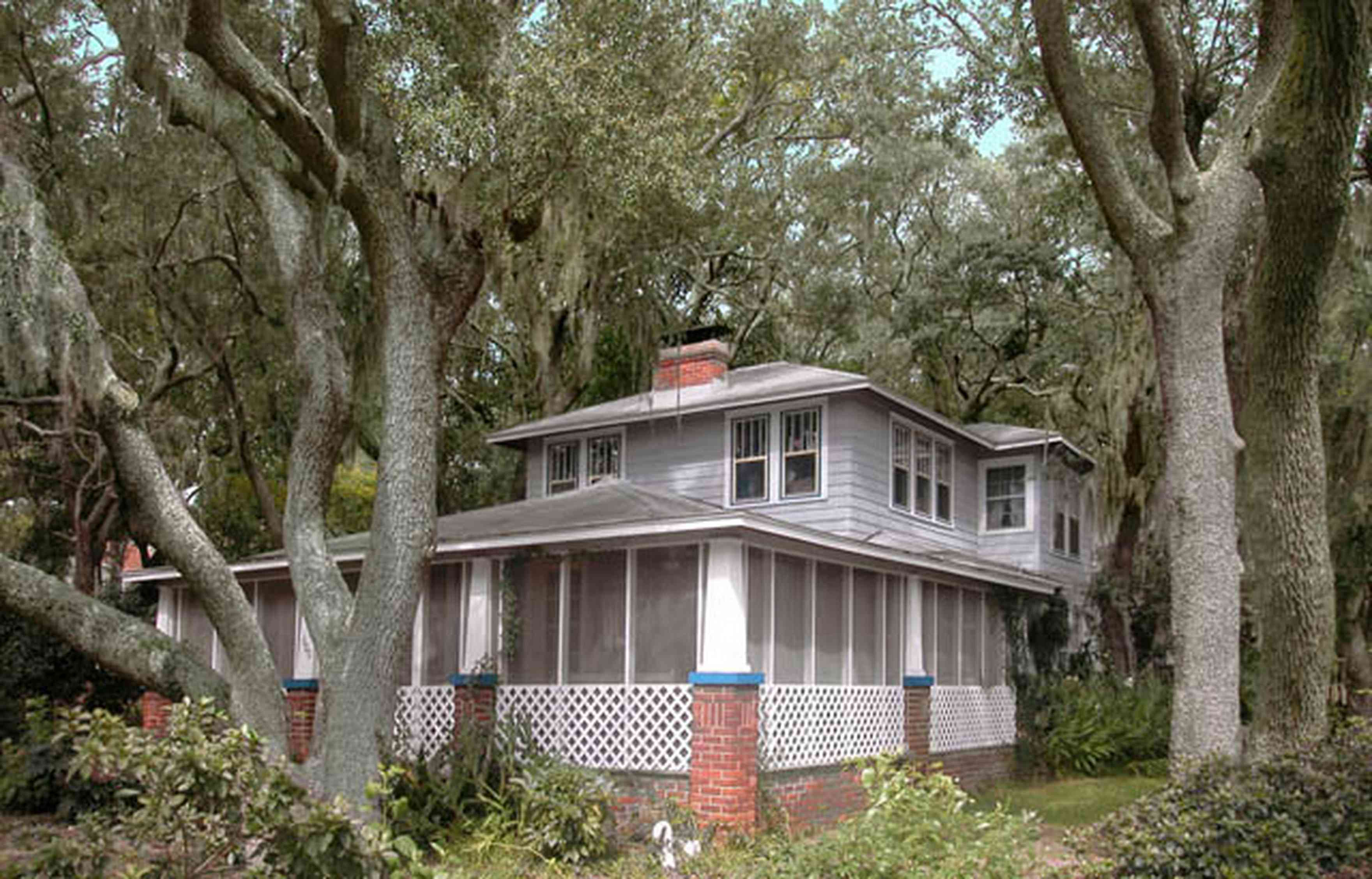 East-Pensacola-Heights:-600-Bayou-Blvd_01.jpg:  live oak trees, spanish moss, azelea bushes, brick pillars, bungalow style,