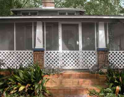 East-Pensacola-Heights:-600-Bayou-Blvd_03.jpg:  latticework, brick pillars, brick sidewalk, brick steps, screened porch, bayou house, front door, craftsman cottage, bungalow, house