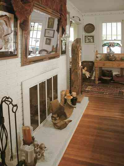 East-Pensacola-Heights:-600-Bayou-Blvd_09.jpg:  hearth, fireplace, heartpine floors, mirror, mantel, oriental rug, stucco walls