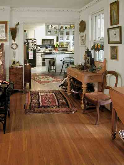 East-Pensacola-Heights:-600-Bayou-Blvd_10.jpg:  heart pine floors, oriental rug, desk, open floor plan, dining area, kitchen, stucco walls