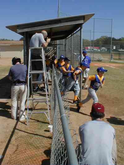 Ensley:-JR-Jones-Ballfield_08.jpg:  photographer, dugout, ball players, mike, little league players