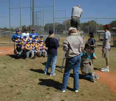 Ensley:-JR-Jones-Ballfield_09.jpg:  photographer, dugout, ball players, mike, little league players