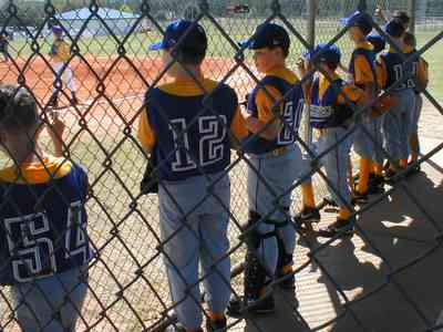 Ensley:-JR-Jones-Ballfield_09a.jpg:  photographer, dugout, ball players, mike, little league players