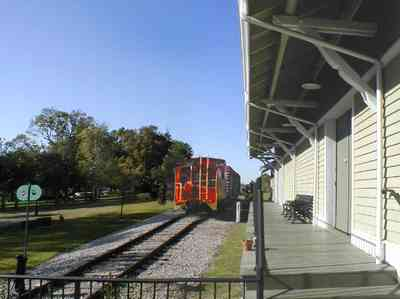 Foley:-Train-Station_03.jpg:  caboose, train station, depot, railroad, rail tracks, victorian architecture, oak trees