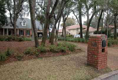 Gulf-Breeze:-228-North-Cliff-Dr_01.jpg:  mailbox, oak trees, driveway, subdivision, waterfront lot