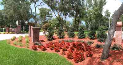 Gulf-Breeze:-706-Fair-Point-Drive_00a-copy.jpg:  gate, entrance, formal driveway, lanterns, oak trees, brick columns