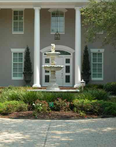 Gulf-Breeze:-72-Highpointe-Drive_03-copy.jpg:  gas lantern, birch trees, circular driveway, fountain, tiled driveway