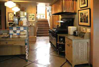 Gulf-Breeze:-92-High-Point-Drive_06.jpg:  kitchen range, restaurant gas range, side board, stairs, copper range hood, tile floor