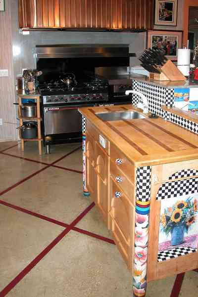 Gulf-Breeze:-92-High-Point-Drive_08.jpg:  sink, sideboard, restaurant stove, knife block, tile floor, coffee grinder