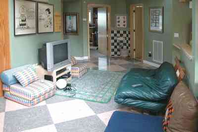 Gulf-Breeze:-92-High-Point-Drive_14a.jpg:  childrens bedroom, playstation, area rug, leather furniture, peanuts cartoons