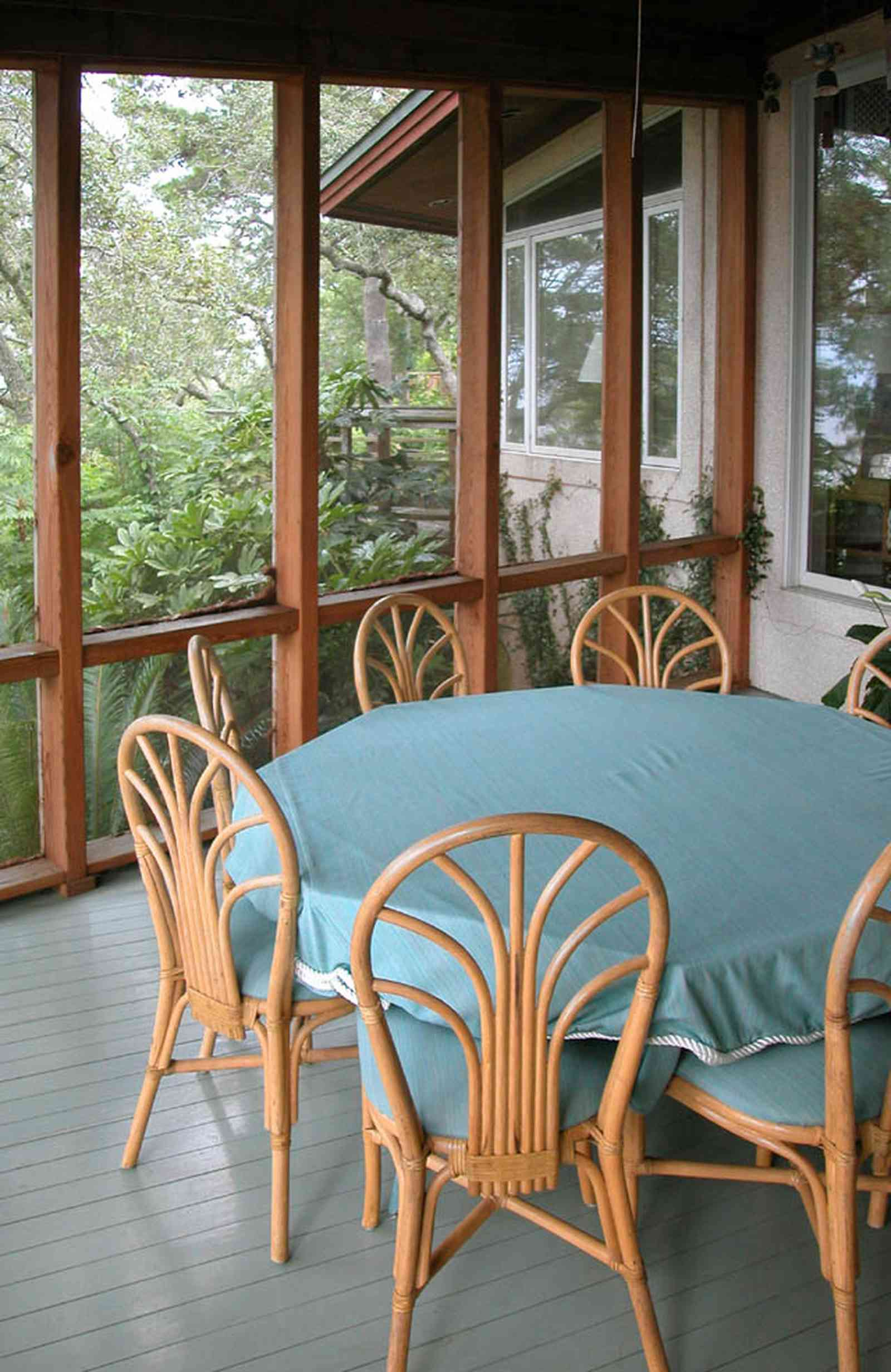 Gulf-Breeze:-92-High-Point-Drive_17a.jpg:  screened porch, bentwood furniture, deck, dining table,