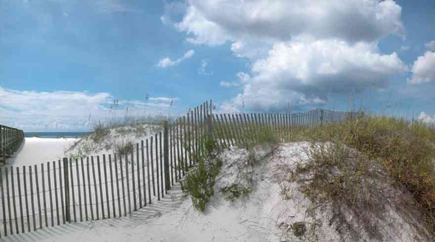 Gulf-Islands-National-Seashore:-Perdido-Key:-Johnson-Beach-Road-Turn-Around_01.jpg:  dune fence, sand dune, sea oats, gulf of mexico, cumulus clouds, boardwalk, barrier island