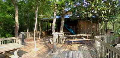 Milton:-Adventures-Unlimited_06.jpg:  picnic table, deck, house, office, store