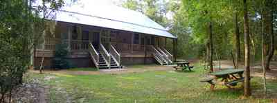 Milton:-Adventures-Unlimited_22.jpg:  cabin, house, home, accomodations, hotel, picnic bench