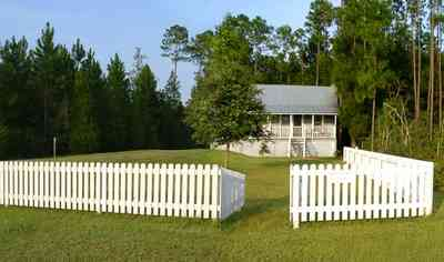 Milton:-Adventures-Unlimited_25.jpg:  cottage, victorian home, picket fence, park, lodge