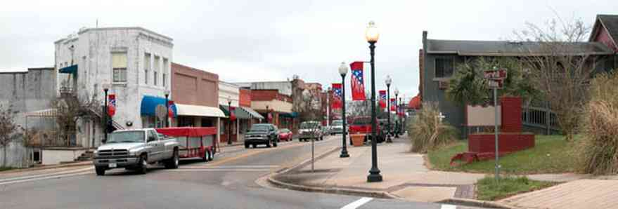 Milton:-Berryhill-And-Broad-Street_02.jpg:  building facades, 19th century village, small town, awnings, store front