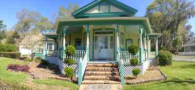 Milton:-Historic-District:-202-Berryhill-Street:-Chadwick-Hartsell-House_05.jpg:  white picket fence, steamboat house, victorian house, gingerbread, pediment, classical elements