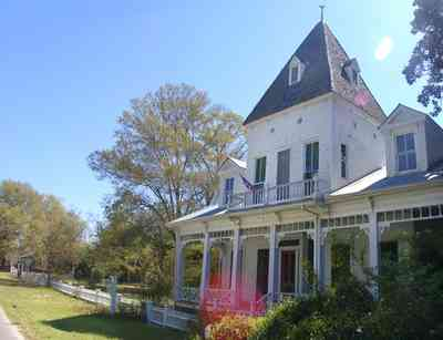 Milton:-Historic-District:-302-Pine-Street:-Ollinger-Tighman-House_02.jpg:  victorian house, arcade, porch, picket fence