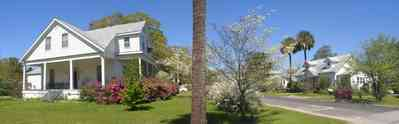Milton:-Historic-District:-Escambia-St-House_02.jpg:  palm tree, azalea bushes, victorian house