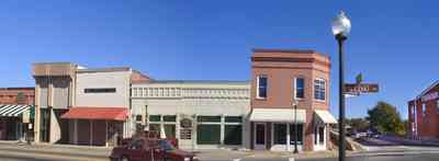 Milton:-Main-Street_04.jpg:  bridge, law office, town square, storefront buildings