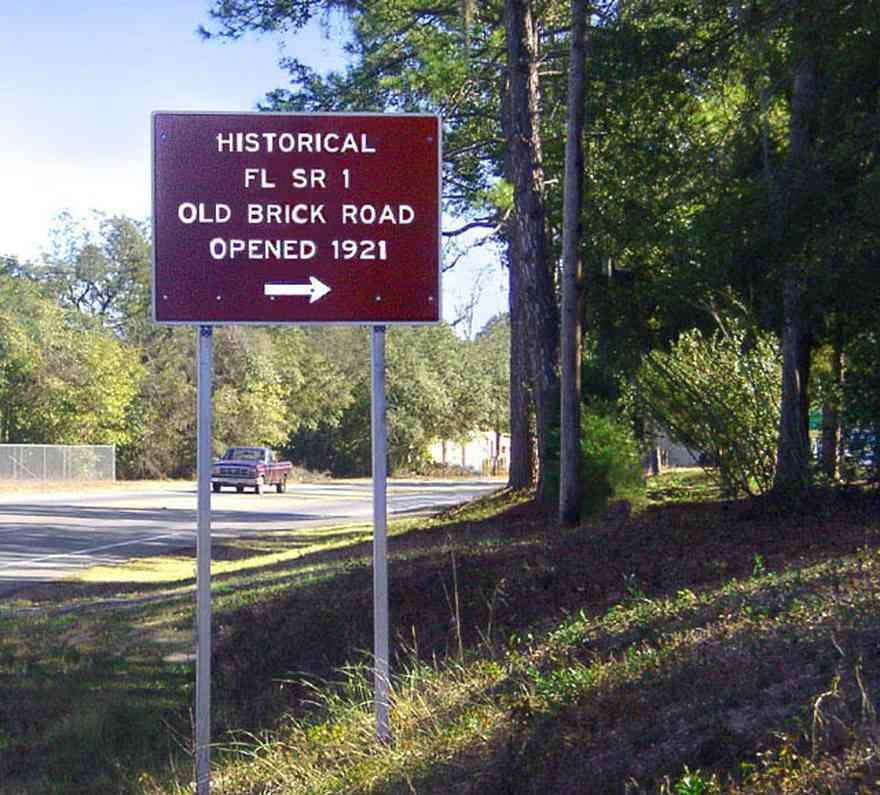 Milton:-Red-Brick-Road_00.jpg:  brick road, historic marker, highway, two-lane road, red brick