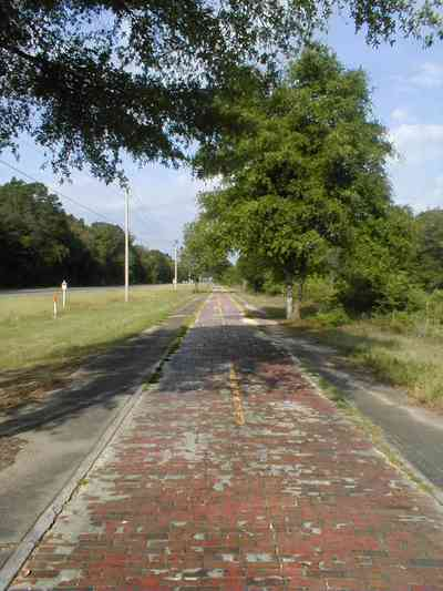 Milton:-Red-Brick-Road_13.jpg:  brick road, historic marker, highway, two-lane road, red brick
