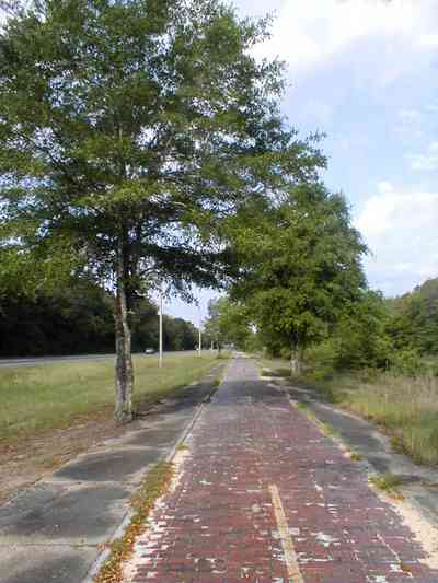 Milton:-Red-Brick-Road_14.jpg:  brick road, historic marker, highway, two-lane road, red brick