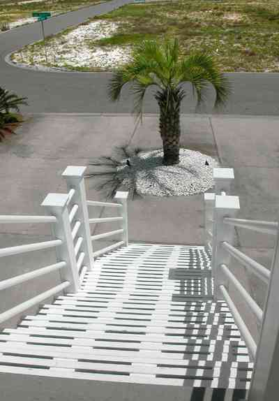 Navarre:-7332-Grand-Navarre-Blvd_01b.jpg:  front stairs, palm tree, driveway, beach house