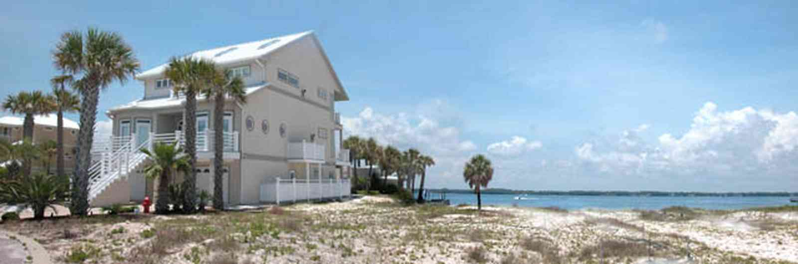 Navarre:-7332-Grand-Navarre-Blvd_02.jpg:  sand dune, palm trees, beach house, santa rosa sound, three-story house, luxury home, cumulus clouds