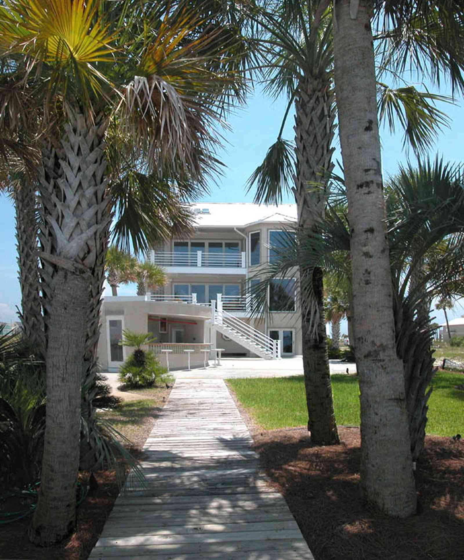 Navarre:-7332-Grand-Navarre-Blvd_05.jpg:  palm trees, cabana bar, beach house, dock, deck